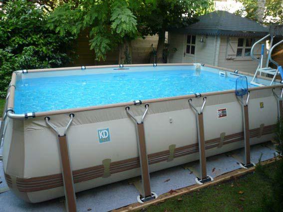 Piscines hors sol construction carr vert for Preparation piscine hors sol